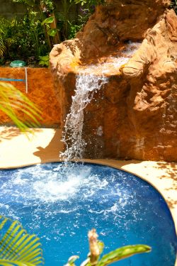 pool with waterfall feature at Roatan Backpackers' Hostel